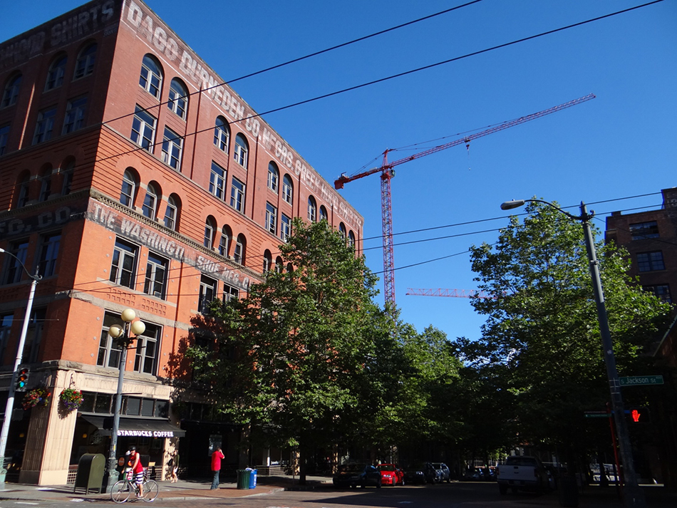 The Washington Shoe Building with cranes at Stadium Place in the background